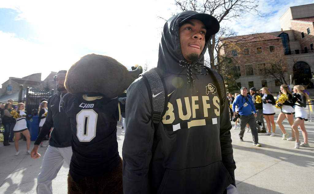 . Shay Fields comes down the Buff Walk before the CU Cal Homecoming game on Saturday.  Cliff Grassmick / Staff Photographer/ October 28, 2017