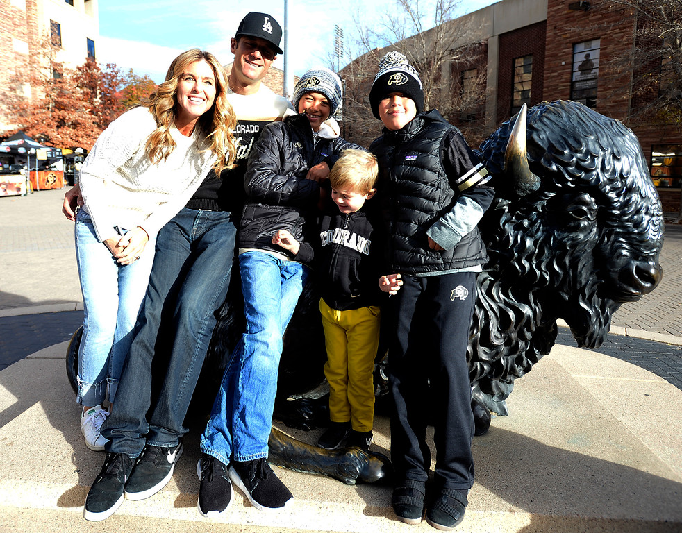 . CU alumni, Meghan Wald (\'94), Darren Wald (92), Kellen, Ryder, and Saxon, pose on the buffalo statue before the CU Cal Homecoming game on Saturday.  Cliff Grassmick / Staff Photographer/ October 28, 2017