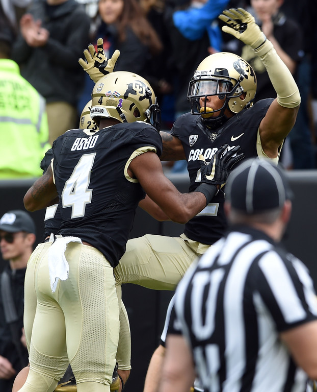 . Bryce Bobo, left, and Devin Ross, of CU, celebrate a TD during the CU Cal Homecoming game on Saturday.  Cliff Grassmick / Staff Photographer/ October 28, 2017