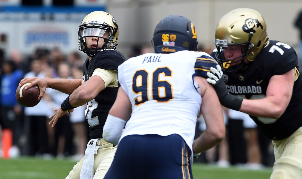 . Steven Montez, of CU, throws downfield during the CU Cal Homecoming game on Saturday.  Cliff Grassmick / Staff Photographer/ October 28, 2017