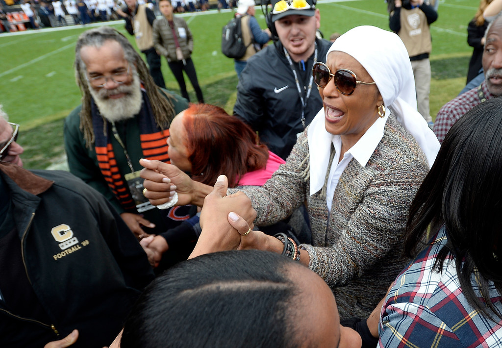 . Rashaan Salaam\'s mother, Khalada Salaam-Alaji, is comforted by friends and family during a ceremony to retire Salaam\'s number 19, during the CU Cal Homecoming game on Saturday.  Cliff Grassmick / Staff Photographer/ October 28, 2017