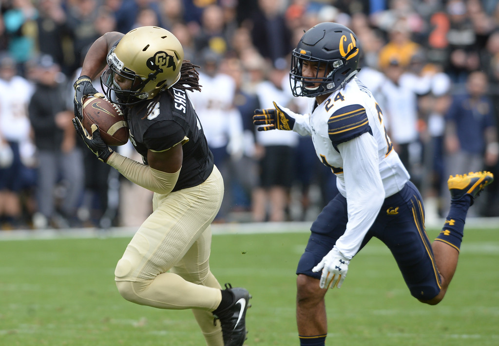 . Laviska Shenault , Jr. gets a long catch past Camryn Bynum, of Cal, during the CU Cal Homecoming game on Saturday.  Cliff Grassmick / Staff Photographer/ October 28, 2017