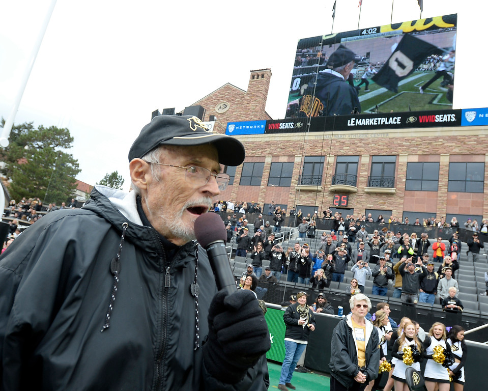 """. Long-time voice of the CU Buffs, Alan Cass, proclaims, \""""Here comes Ralphie!\"""" during the CU Cal Homecoming game on Saturday.  Cliff Grassmick / Staff Photographer/ October 28, 2017"""