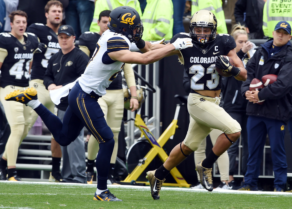 . Phillip Lindsay, of CU,  gets a huge gain during the CU Cal Homecoming game on Saturday.  Cliff Grassmick / Staff Photographer/ October 28, 2017