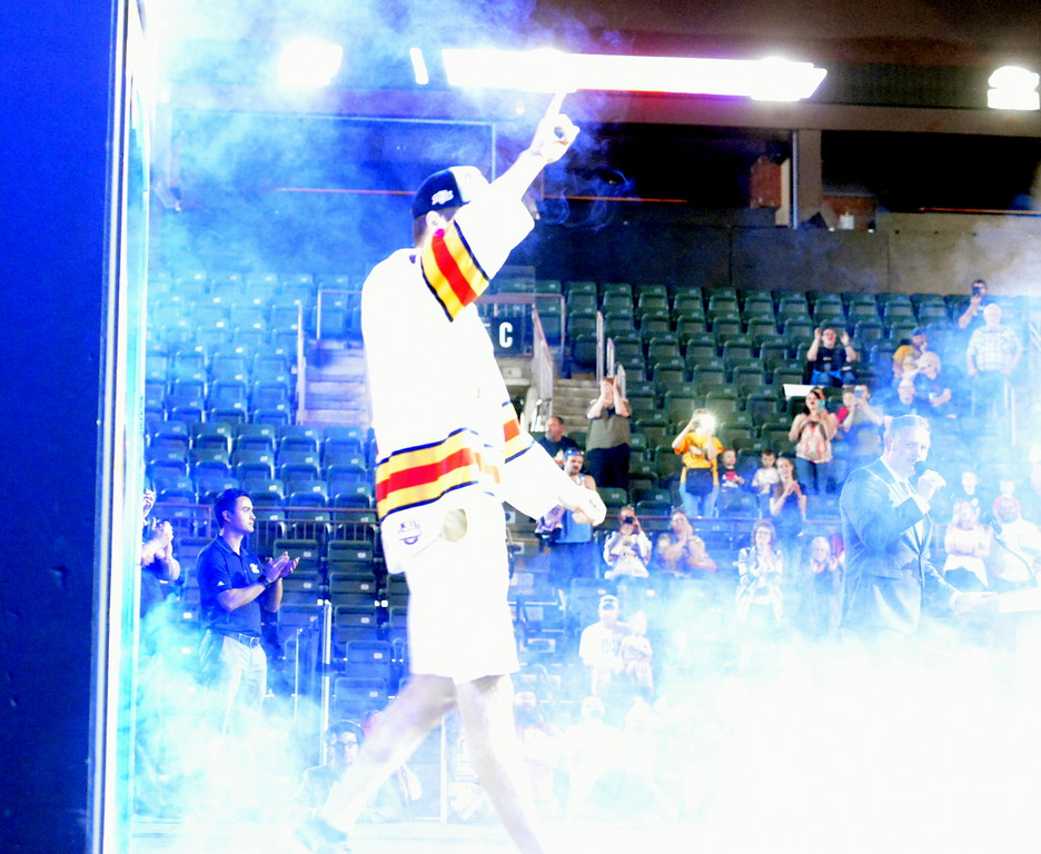 . Colorado Eagles defenseman Ben Storm acknowledges the crowd as he walks on the stage Tuesday night at the Budweiser Events Center. The team was celebrating back-to-back ECHL championships with the fans. (Mike Brohard/Loveland Reporter-Herald).