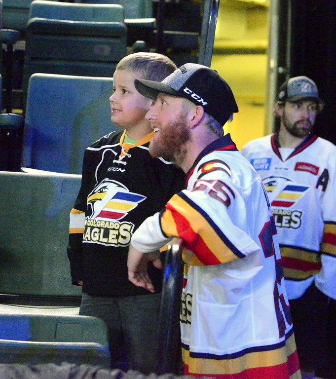 . Colorado Eagles player Jake Marto poses with a fan as the players wait to take the stage at the Budweiser Events Center on Tuesday. The team opened up the arena to celebrate back-to-back ECHL championships with the fans. (Mike Brohard/Loveland Reporter-Herald).