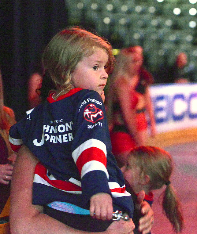 . Maddie McGlue, daughter of Colorado Eagles  radio announcer Kevin McGlue, takes in the sights and sounds of Tuesday\'s celebration party at the Budweiser Events Center from backstage. (Mike Brohard/Loveland Reporter-Herald).