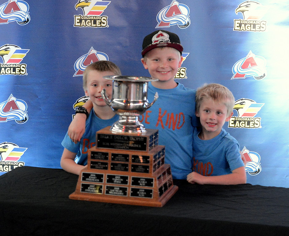 . Dezmond, Zildgian and Zenith Heinze of Windsor pose with the Kelly Cup at the Colorado Eagles open house at the Budweiser Events Center on Tuesday. The team was celebratng back-to-back ECHL titles. (Mike Brohard/Loveland Reporter-Herald).