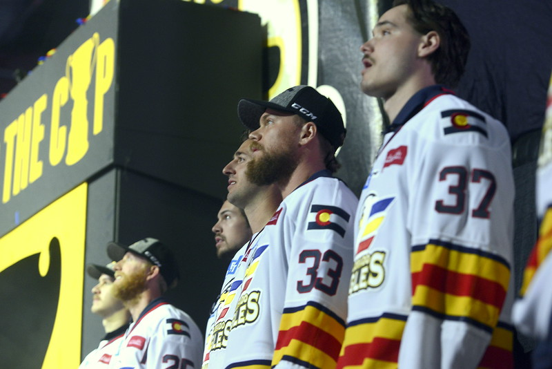 Colorado Eagles players watch a replay of the clinching moments of their ECHL championship while standing on stage during their celebration party at the Budweiser Events Center oon Tuesday. (Mike Brohard/Loveland Reporter-Herald).