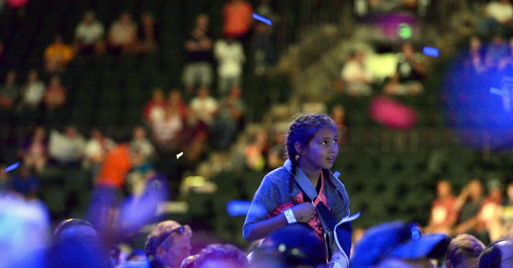 . A young fans sits on her father\'s shoulders as confetti falls from the rafters during the Colorado Eagles celebration party for back-to-back ECHL championships on Tuesday at the Budweiser Events Center. (Mike Brohard/Loveland Reporter-Herald).