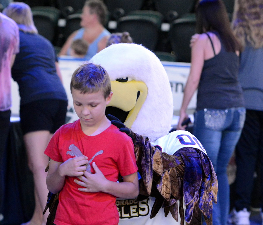 . Colorado Eagles mascot Slapshot signs the back of a young fan at the celebration party at the Budweiser Events Center on Tuesday. The Eagles repeated as ECHL champions this year. (Mike Brohard/Loveland Reporter-Herald).