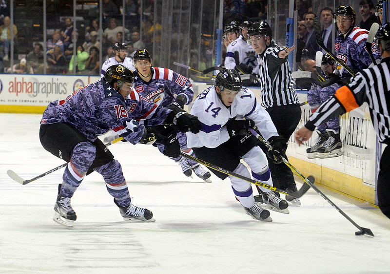 Colorado Eagles Teigan Sahn, left, tries to get the puck from Royals Mike Pereira during their game at the Budweiser Events Center on Wednesday, Nov. 2, 2016, in Loveland. (Photo by Jenny Sparks/Loveland Repdorter-Herald)