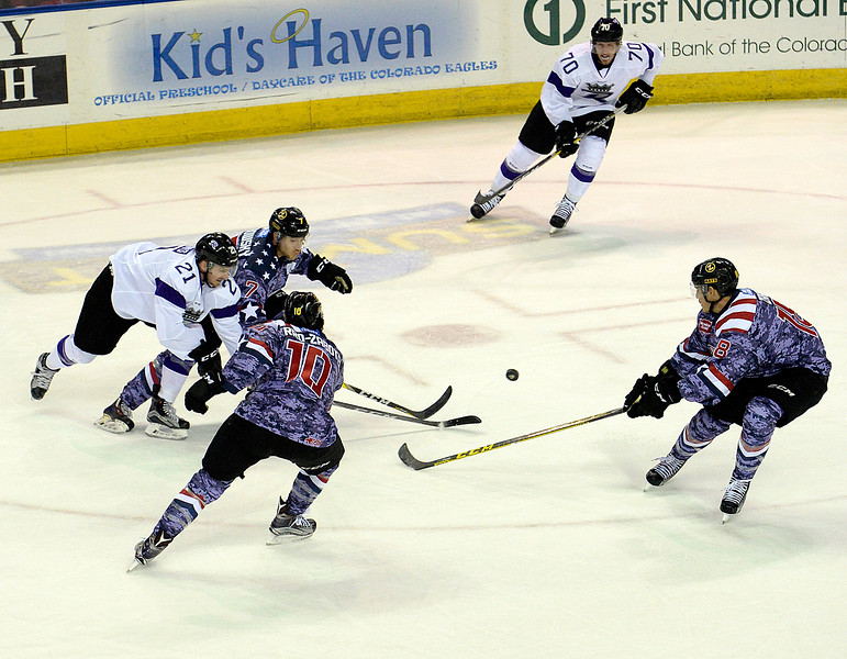 Colorado Eagles players surround Royals Matt Wilkins during their game at the Budweiser Events Center on Wednesday, Nov. 2, 2016, in Loveland. Eagles players clockwise from top left are Matt Garbowsky, Casey Pierro-Zabotel, and Sean Zimmerman. (Photo by Jenny Sparks/Loveland Reporter-Herald)