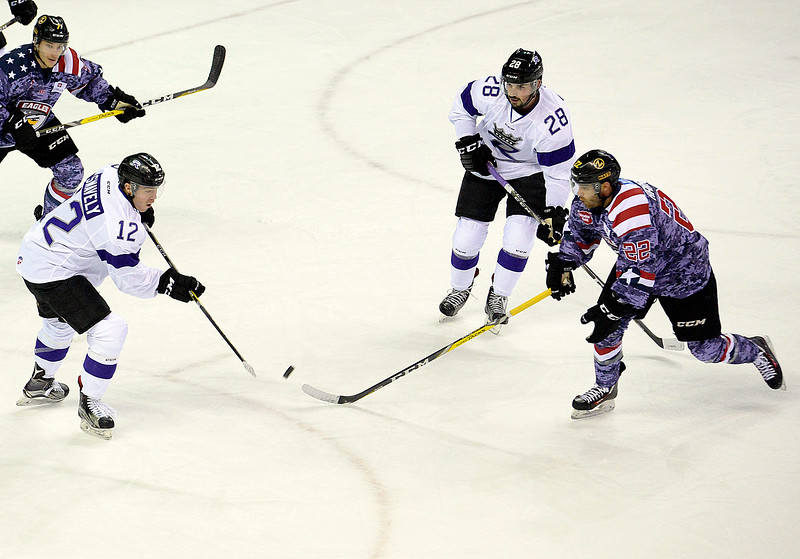 Colorado Eagles Ryan Harrison, right, left, and Royals Steven Swavely go for the puck during their game at the Budweiser Events Center on Wednesday, Nov. 2, 2016, in Loveland. (Photo by Jenny Sparks/Loveland Reporter-Herald)