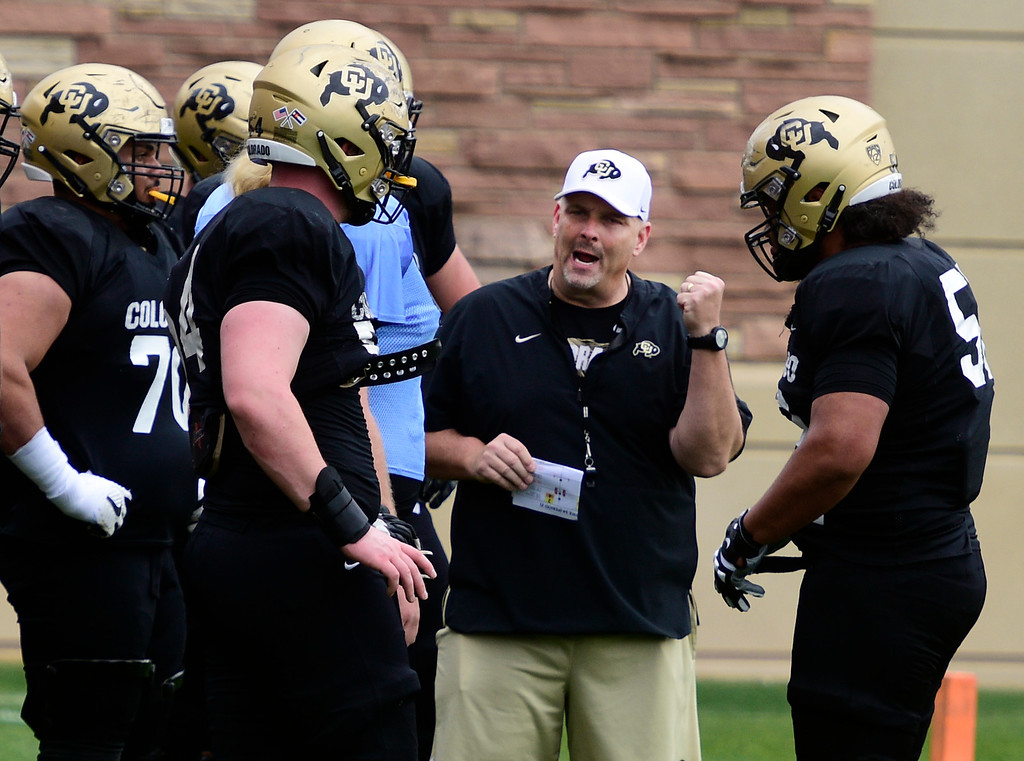 . BOULDER, CO - April 24, 2019: Chris Kapilovic, OL coach, at CU Spring football practice on April 24, 2019. (Photo by Cliff Grassmick/Staff Photographer)