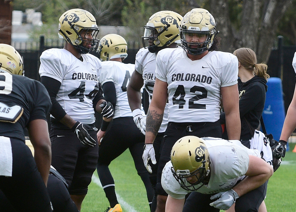 . BOULDER, CO - April 24, 2019: Jacob Callier, left, and Nu\'umotu Falo Jr.,  at CU Spring football practice on April 24, 2019. (Photo by Cliff Grassmick/Staff Photographer)
