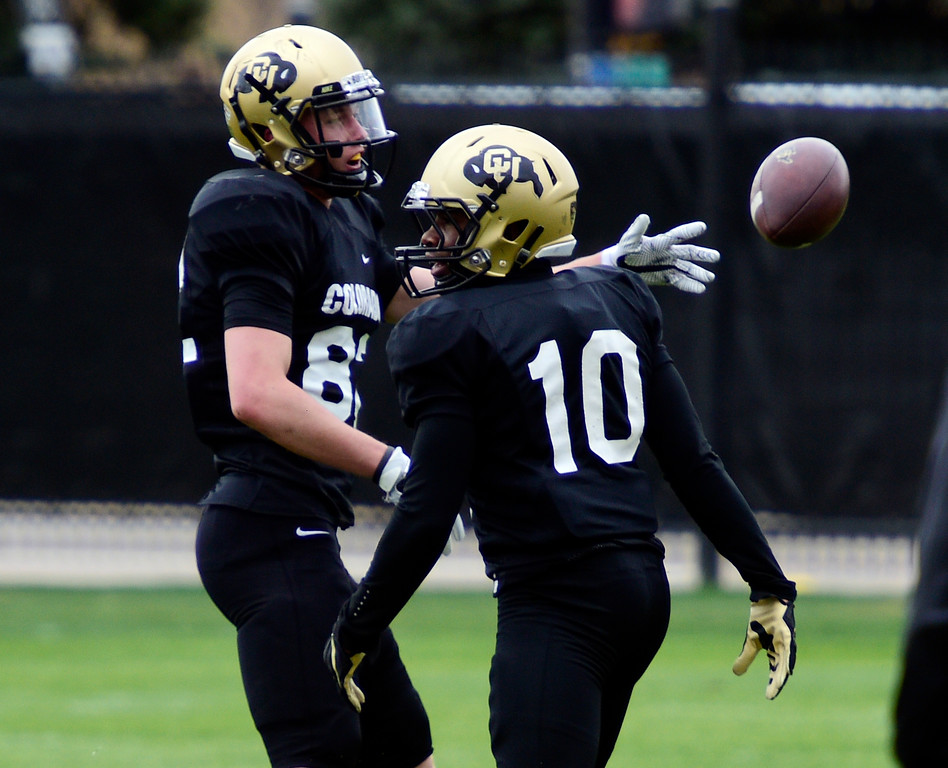 . BOULDER, CO - April 24, 2019:  Receivers, Jake Groth, left, and Jaylon Jackson, at CU Spring football practice on April 24, 2019. (Photo by Cliff Grassmick/Staff Photographer)