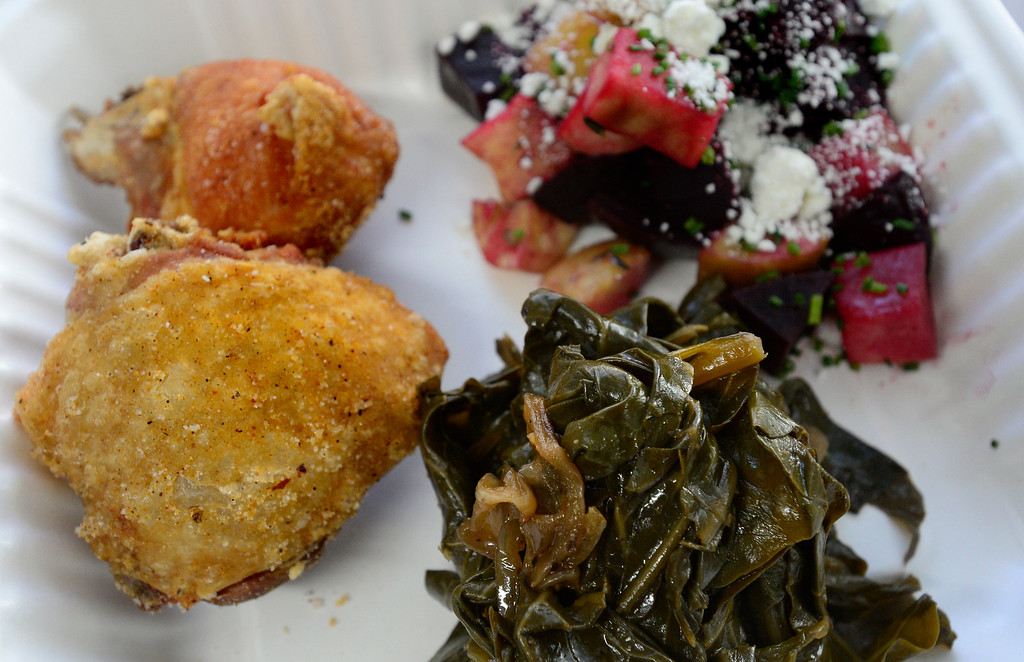 . BOULDER, CO - FEBRUARY 7, 2019 The dry rubbed fried chicken, beets and apples and collard greens prepared by Aaron Quilling of the Colorado Fried Chicken Company outside Wild Woods Brewery in Boulder on Thursday February 7 2019. For more photos go to dailycamera.com (Photo by Paul Aiken/Staff Photographer)
