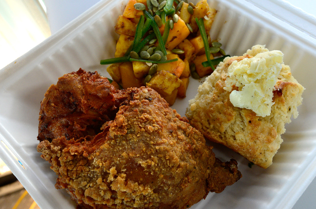 . BOULDER, CO - FEBRUARY 7, 2019 Classic Breaded Fried Chicken, buttermilk biscuit and soy ginger squash prepared by Aaron Quilling of the Colorado Fried Chicken Company in his food truck outside Wild Woods Brewery in Boulder on Thursday February 7 2019. For more photos go to dailycamera.com (Photo by Paul Aiken/Staff Photographer)