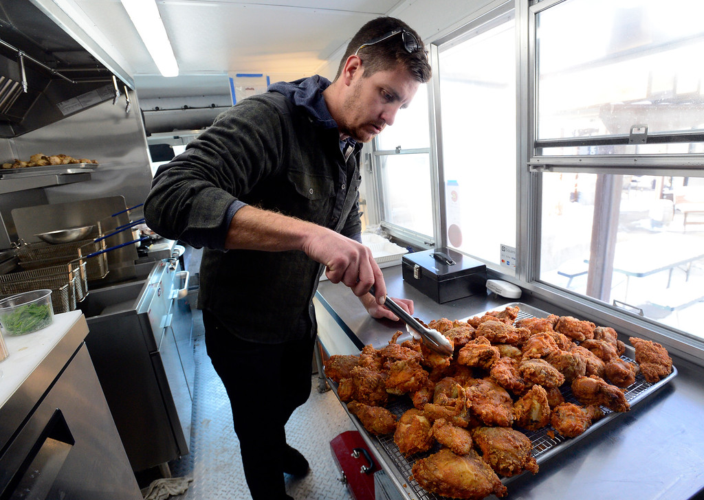 . BOULDER, CO - FEBRUARY 7, 2019 Aaron Quilling, of the Colorado Fried Chicken Company, prepares to set up orders in his truck outside Wild Woods Brewery in Boulder on Thursday February 7 2019. For more photos go to dailycamera.com (Photo by Paul Aiken/Staff Photographer)