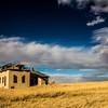 Old Homestead Under Blue Skies