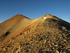 Red Cloud Peak and the loose rubble on the ridge in the morning light.