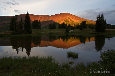 We waited in flat light for about 45 minutes for this picture.  Just when we thought the sun had probably avoided us, it dropped below the clouds on the horizon and lit Cinnamon Mountain up providing a breathtaking look through this pond.