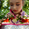 """Venesa Lang, with Baila Conmigo Dance Company, changes her attire for the next performance during the Colorado Latino Festival in Longmont on Sunday. <br /> More photos:  <a href=""""http://www.dailycamera.com"""">http://www.dailycamera.com</a><br /> (Autumn Parry/Staff Photographer)<br /> June 26, 2016"""