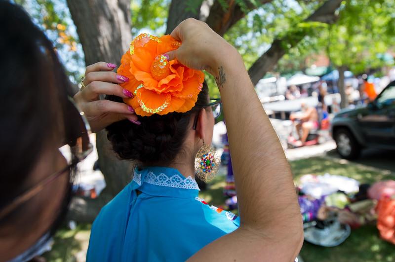 "Monica Quesada helps her daughter Dominiqua Quesada, with Baila Conmigo Dance Company, prepare for the next performance during the Colorado Latino Festival in Longmont on Sunday. <br /> More photos:  <a href=""http://www.dailycamera.com"">http://www.dailycamera.com</a><br /> (Autumn Parry/Staff Photographer)<br /> June 26, 2016"
