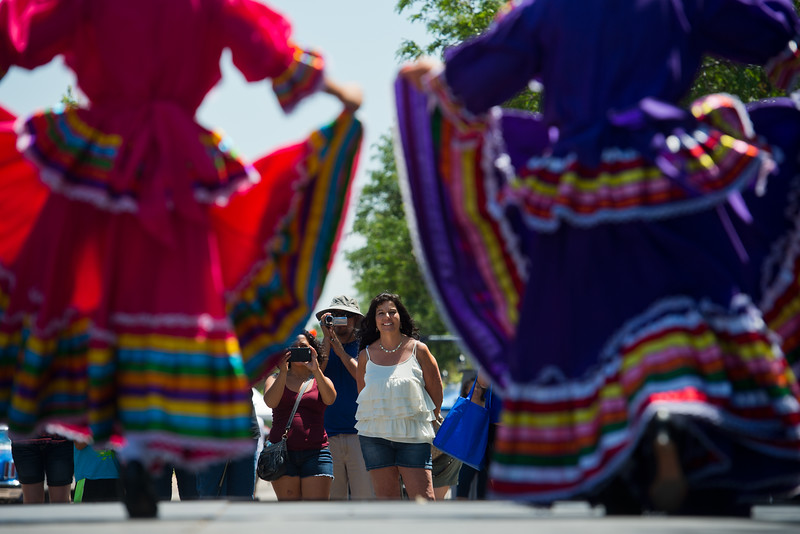 "Bernadette Cannady watches as dancers from Baila Conmigo Dance Company perform during the Colorado Latino Festival in Longmont on Sunday. <br /> More photos:  <a href=""http://www.dailycamera.com"">http://www.dailycamera.com</a><br /> (Autumn Parry/Staff Photographer)<br /> June 26, 2016"