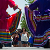 """Bernadette Cannady watches as dancers from Baila Conmigo Dance Company perform during the Colorado Latino Festival in Longmont on Sunday. <br /> More photos:  <a href=""""http://www.dailycamera.com"""">http://www.dailycamera.com</a><br /> (Autumn Parry/Staff Photographer)<br /> June 26, 2016"""
