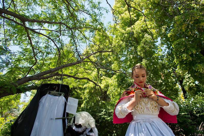 "Venesa Lang, with Baila Conmigo Dance Company, changes her attire for the next performance during the Colorado Latino Festival in Longmont on Sunday. <br /> More photos:  <a href=""http://www.dailycamera.com"">http://www.dailycamera.com</a><br /> (Autumn Parry/Staff Photographer)<br /> June 26, 2016"
