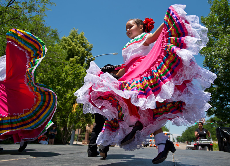 "Isabella Damian, 6, dances ""La Raspa"" with other members of the Baila Conmigo Dance Company, during the Colorado Latino Festival in Longmont on Sunday. <br /> More photos:  <a href=""http://www.dailycamera.com"">http://www.dailycamera.com</a><br /> (Autumn Parry/Staff Photographer)<br /> June 26, 2016"
