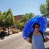 """Mercy Ramirez shades herself with an umbrella at the Colorado Latino Festival in Longmont on Sunday. <br /> More photos:  <a href=""""http://www.dailycamera.com"""">http://www.dailycamera.com</a><br /> (Autumn Parry/Staff Photographer)<br /> June 26, 2016"""