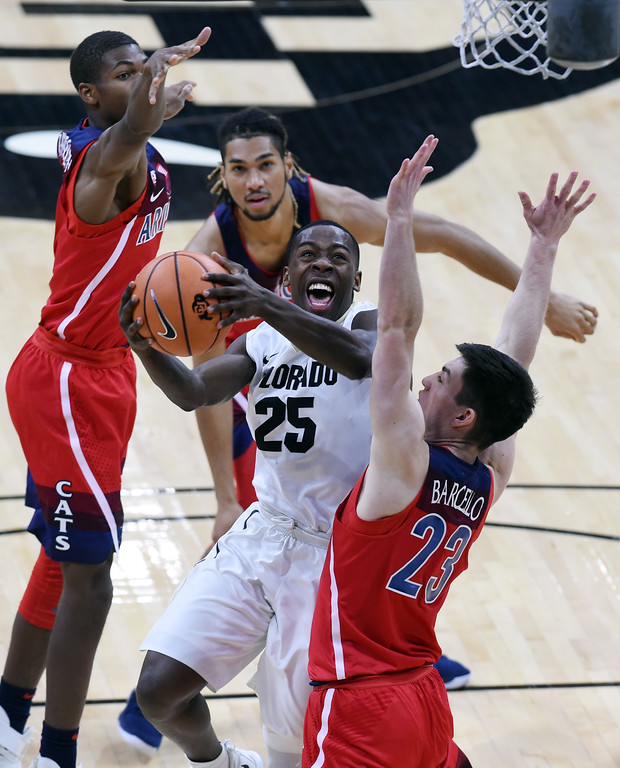 . McKinley Wright IV, of CU, drives to the basket on Alex Barcello, among others from Arizona.  Cliff Grassmick / Staff Photographer/ January 6, 2018