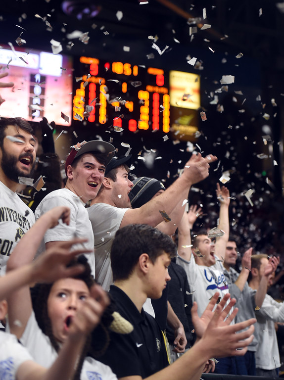 . CU fans throw up newspaper after the first basket against Arizona   on January 6, 2018.  Cliff Grassmick / Staff Photographer/ January 6, 2018