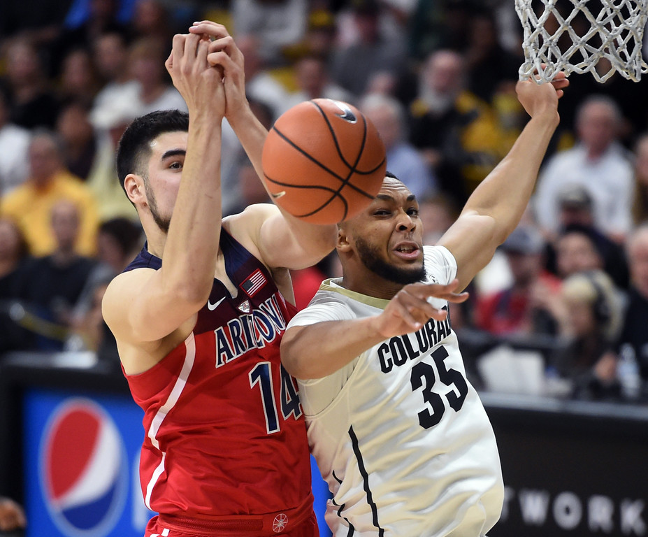 . Dusan Ristic, left, of Arizona, and Dallas Walton battle on the boards in the second half of an NCAA college basketball game on January 6, 2018.  Cliff Grassmick / Staff Photographer/ January 6, 2018