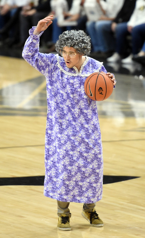 . Gramma takes a shot for $100 in the second half of an NCAA college basketball game on January 6, 2018.  Cliff Grassmick / Staff Photographer/ January 6, 2018