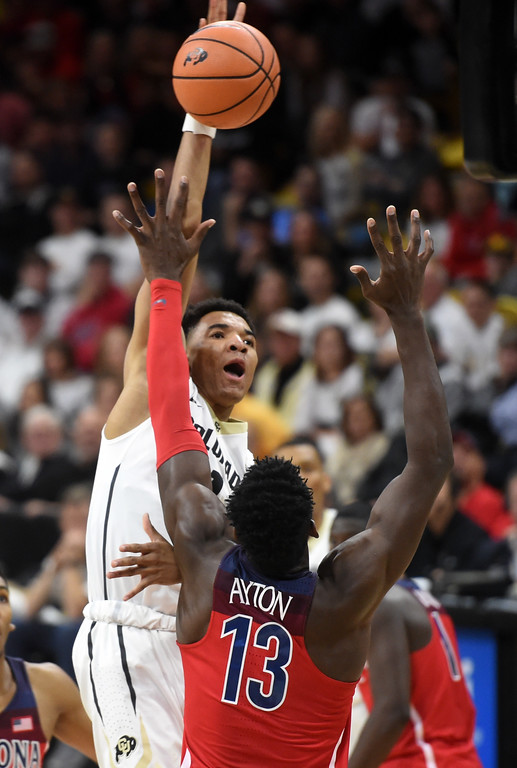 . Tyler Bey, of CU, shoots over Deandre Ayton, of Arizona, in the second half of an NCAA college basketball game on January 6, 2018.  Cliff Grassmick / Staff Photographer/ January 6, 2018