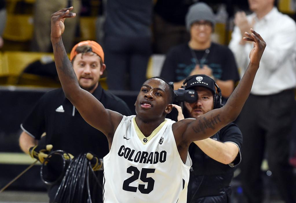 . McKinley Wright IV, of CU, celebrates the upset win over Arizona  on January 6, 2018.  Cliff Grassmick / Staff Photographer/ January 6, 2018
