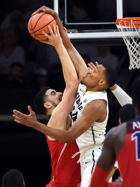 . George King, of CU, blocks the shot of Dusan Ristic, of Arizona, in the first half of the game on January 6, 2018.  Cliff Grassmick / Staff Photographer/ January 6, 2018