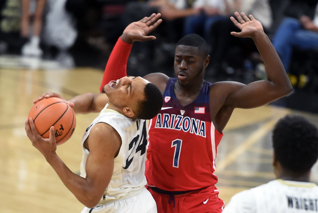 . George King, of CU , gets an elbow from Rawle Alkins, of UA, in the second half of an NCAA college basketball game on January 6, 2018.  Cliff Grassmick / Staff Photographer/ January 6, 2018