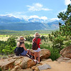Girls enjoying beautiful view on hiking trip.