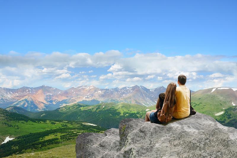 Couple enjoying beautiful mountain view on hiking trip.