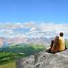 Couple enjoying beautiful mountain view on hiking trip.