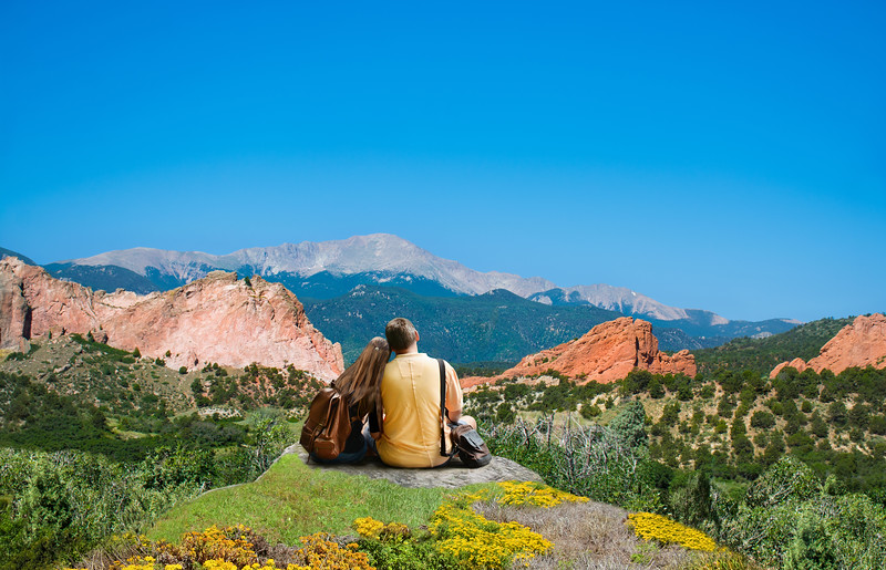 Happy couple resting and enjoying beautiful mountain view. People relaxing on vacation.  Garden of the Gods, Colorado Springs, Colorado, USA.