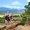 Family  looking at beautiful summer mountains landscape.