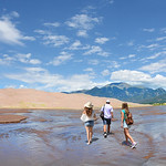 Family hiking in the mountains on vacation trip. Great Sand Dunes National Park ,Colorado, USA.