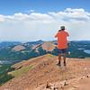 Man on a hiking trip taking photos.