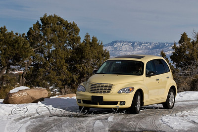 PT Cruiser on Colorado National Monument. Grand Mesa in the distance.